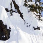 Big air in the backcountry on a snowboard