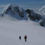 Cruising across the glacier, Mount Slalock behind
