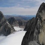 Climbers on the West Ridge of Pigeon Spire,  Bugaboo Spire in the distance