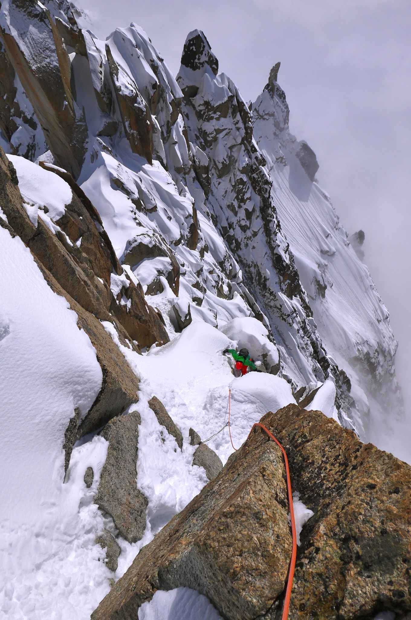 Climbing the last pitch of the Cosmiques Arete