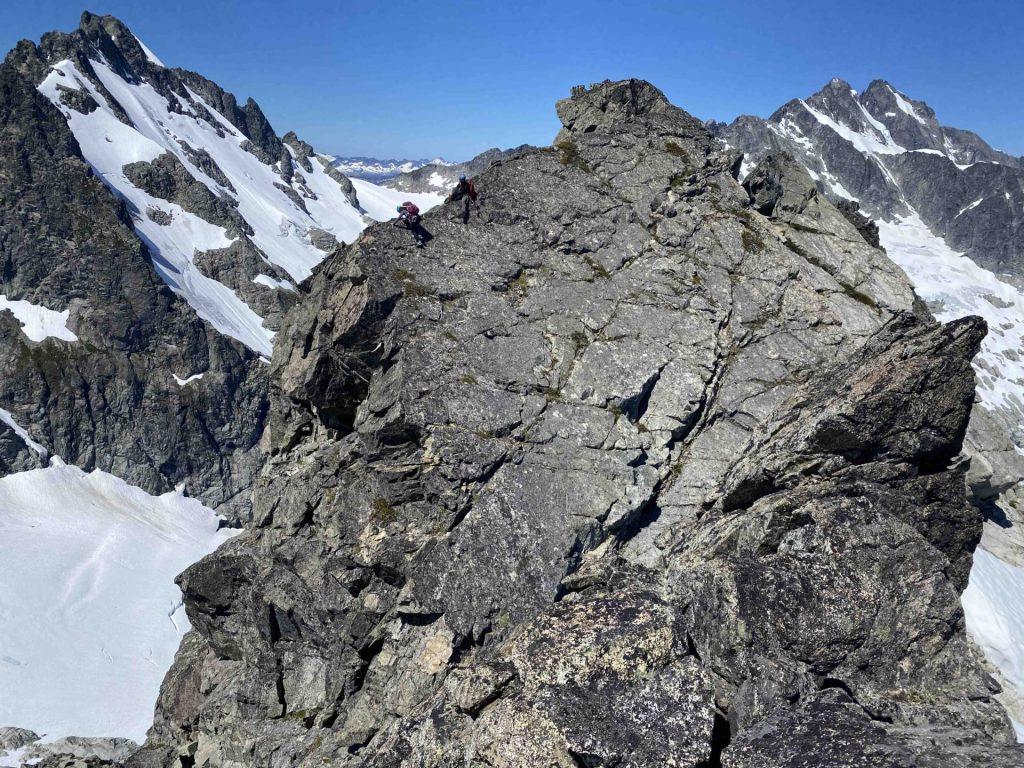 Flat ridge after knife edge, down climbing into notch.
